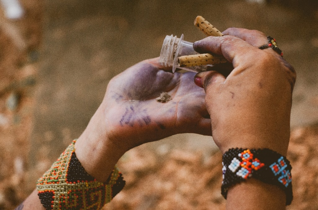 hands holding vial, indigenous medicine, ancient culture, psychedelic use