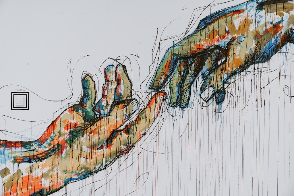 painted mural hands touching, psychedelic assisted therapy vs integration