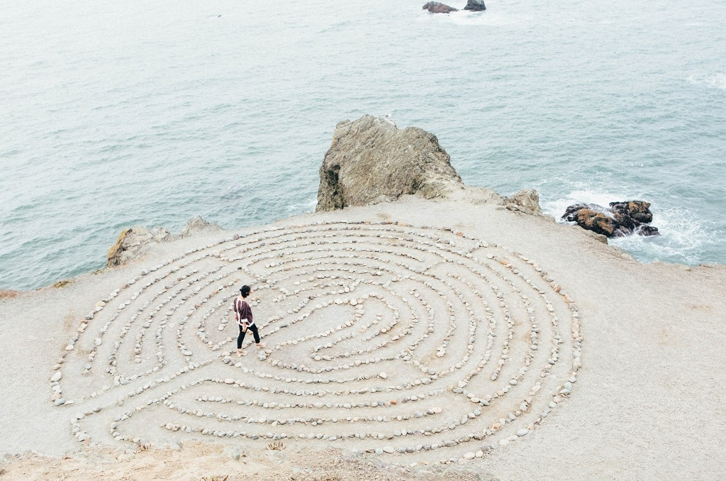 woman walking beach labyrinth, psychedelic future direction, paranormal phenomena