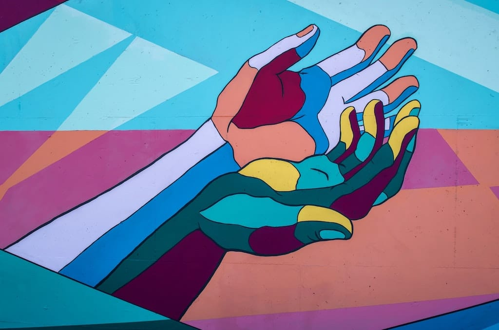 multicolor mural of hands reaching out, psychedelic dosage guide