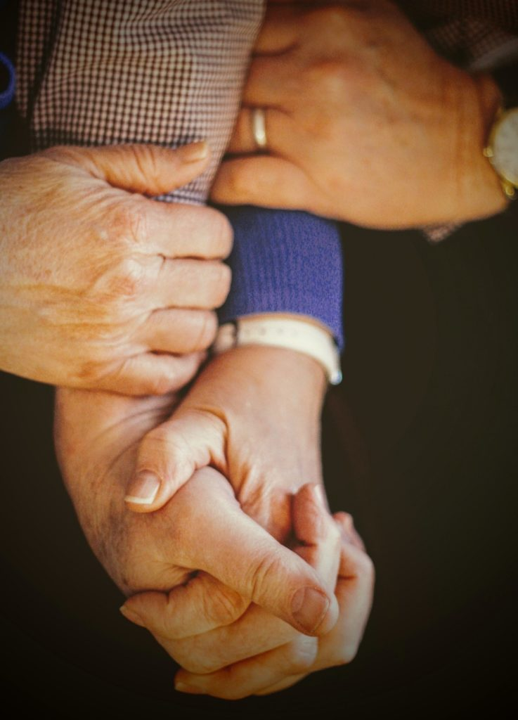 elderly couple holding hands, pursue psychedelics with proper support