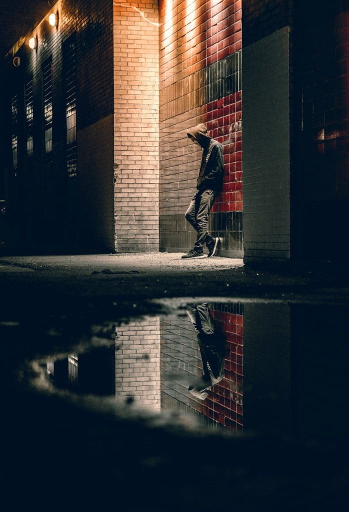 man in hoodie in alley, share psychedelic experiences