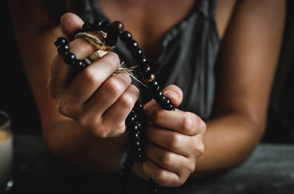 woman holding mala beads bad trip psychedelic dosage guide