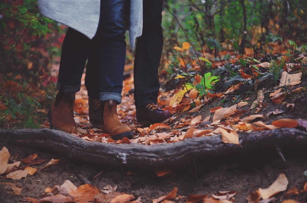 man and woman walking through leaves, change your environment during a psychedelic bad trip