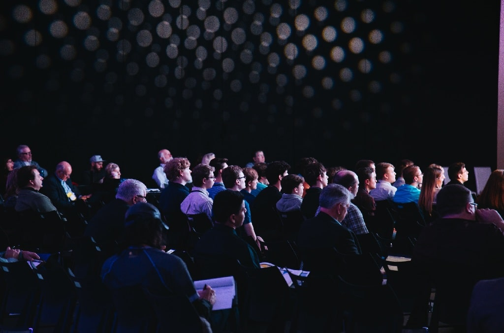 audience attend a psychedelic conference