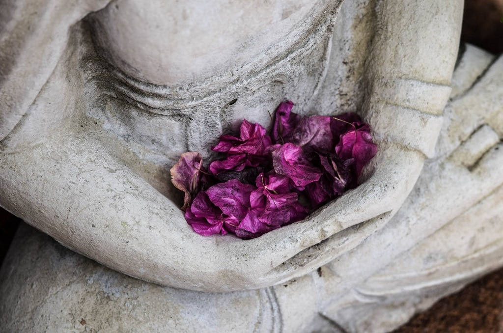 buddha statue with purple flowers, psychedelic ego death, god