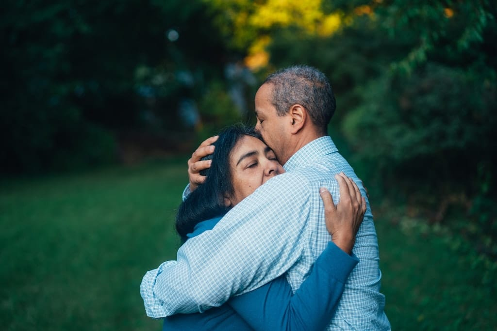 two people hugging outside, is psychedelic assisted therapy legal
