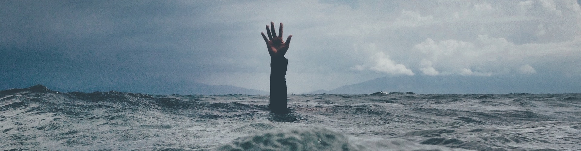 hand reaching out of water, how to use psychedelics for stress relief