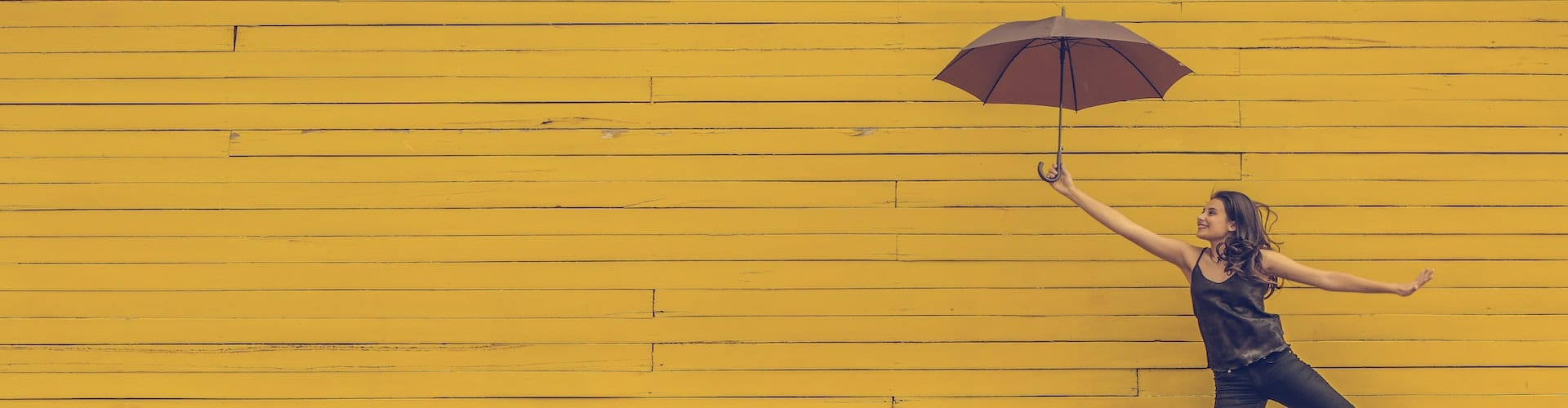 woman holding umbrella yellow background, what are the long-term effects of psychedelic use