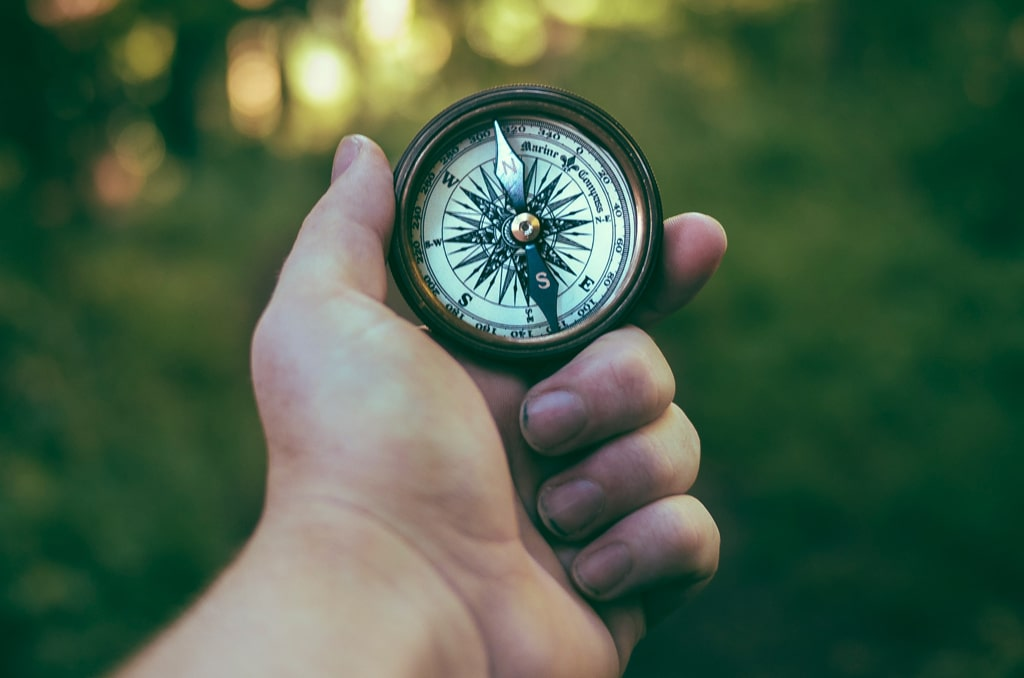 hand holding compass, how to choose the right psychedelic substance guide
