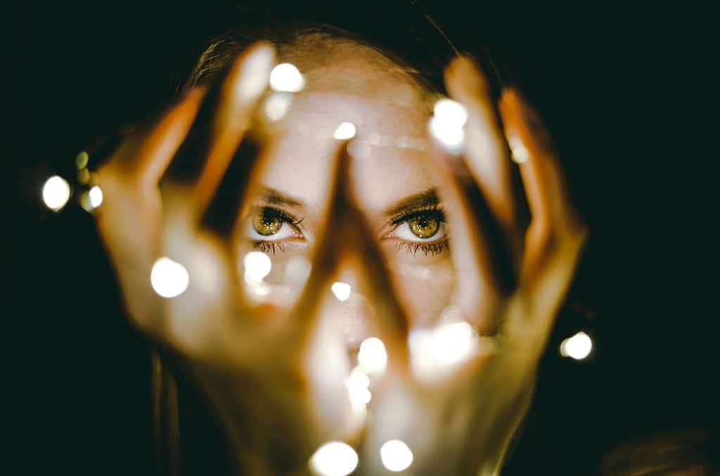 woman holding lights near face, psychedelics and personal growth