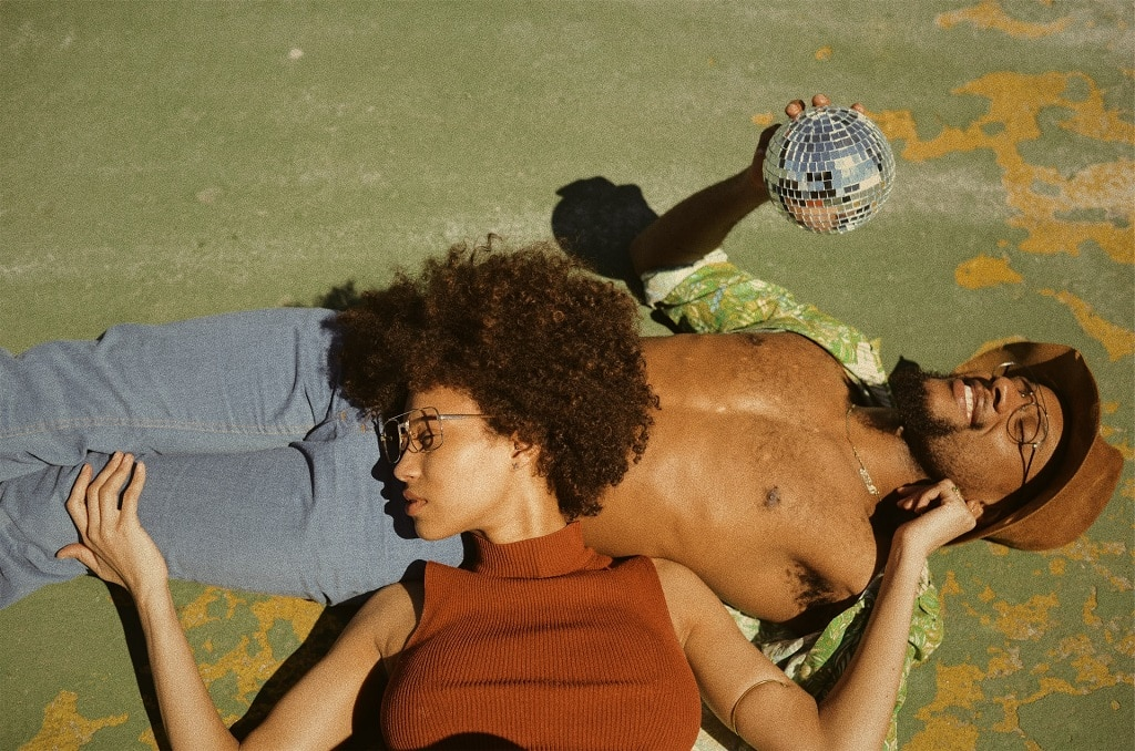 black couple relaxing, holding disco ball, mdma therapeutic benefits