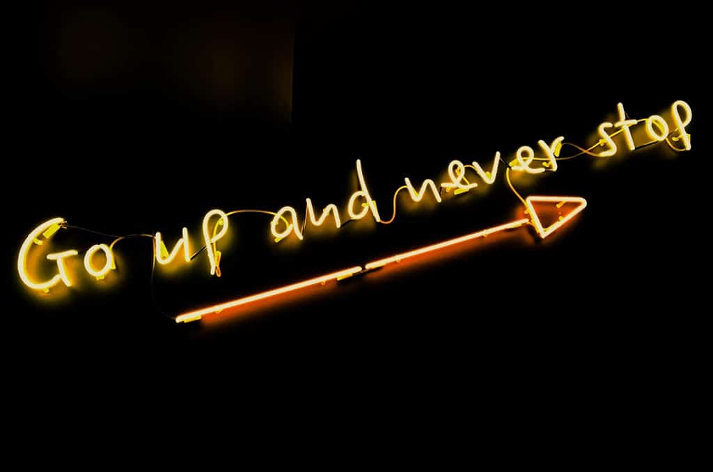 neon sign that says go up and never stop, why intention and context matter with psychedelics
