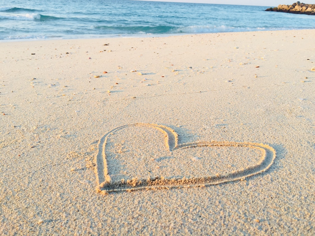 heart in sand at beach, how to prepare for a psychedelic journey