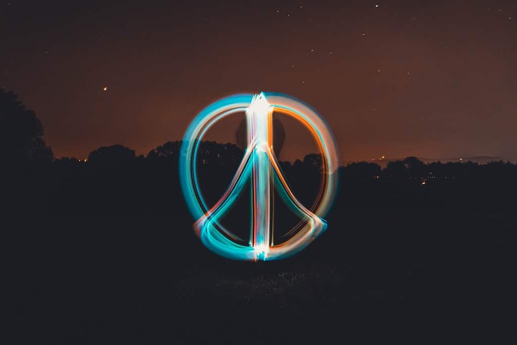 person light painting a peace sign at night, how to use psychedelics for stress relief