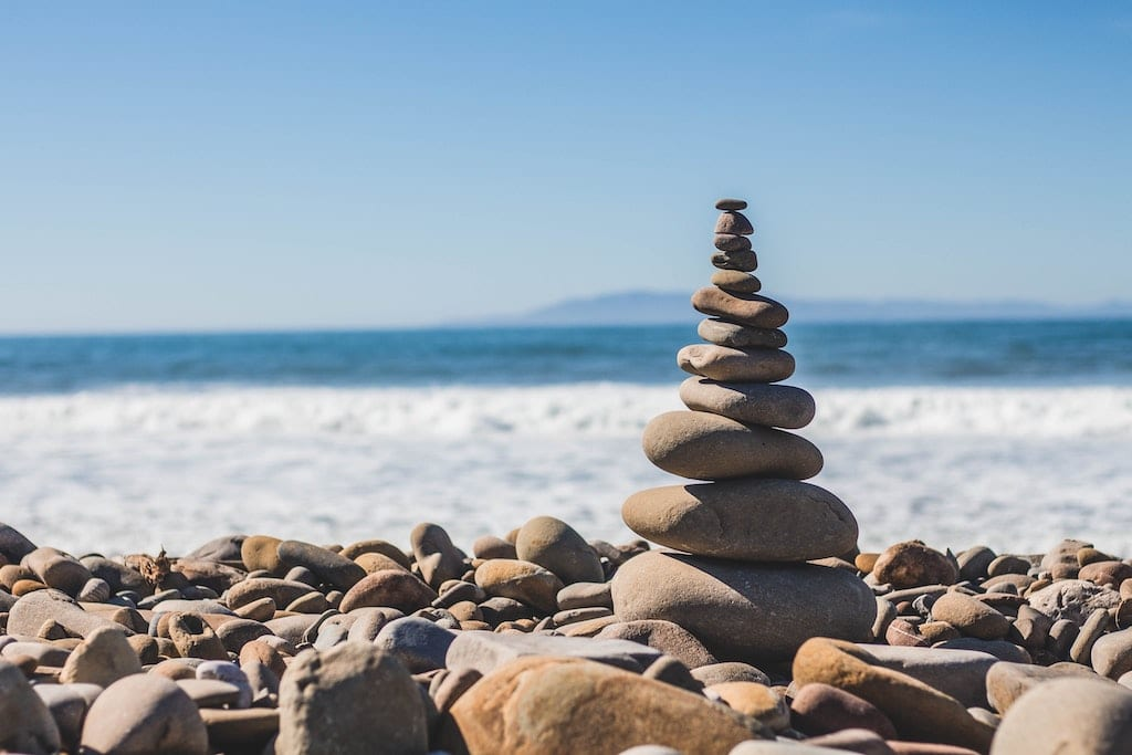 rock cairn by beach, where to get psychedelics legally