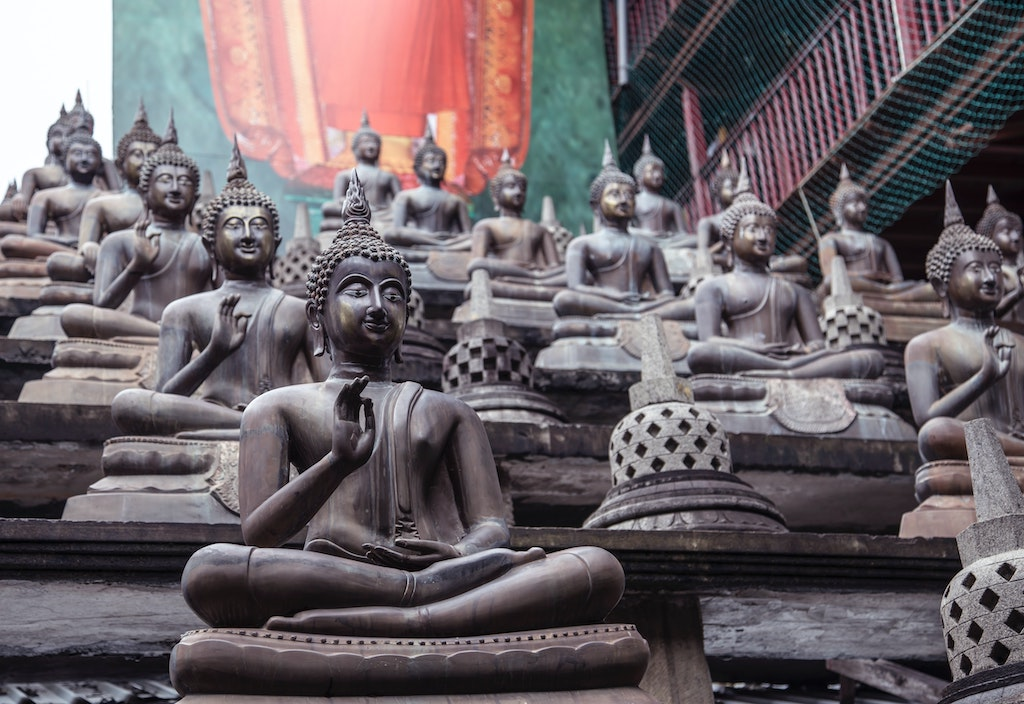 buddha statues on steps, how can psychedelics benefit happy people
