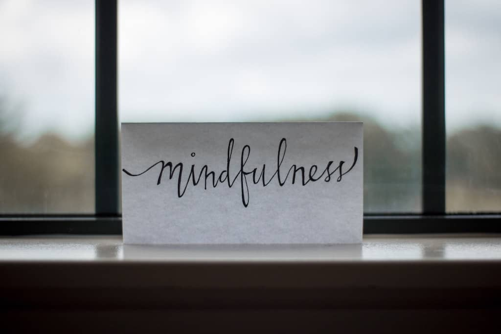 mindfulness written on paper, how to prepare for a psychedelic journey