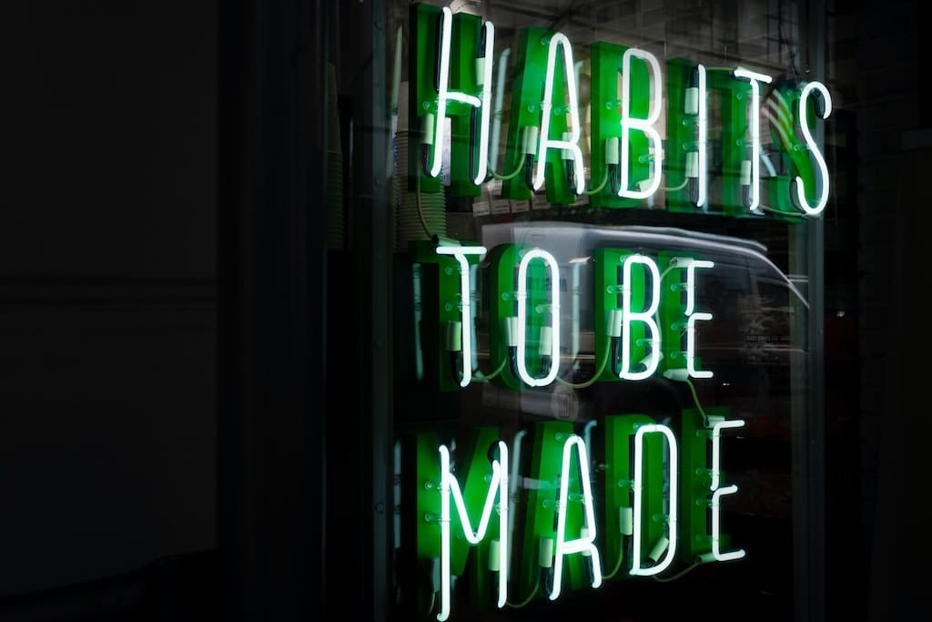 neon sign that says habits to be mad, how can psychedelics benefit happy people