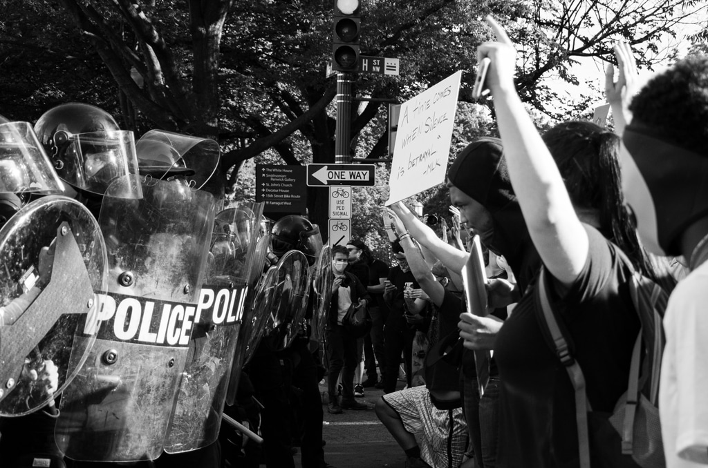 police and protesters face each other at black lives matter protest in washington DC, drug policy and racial injustice